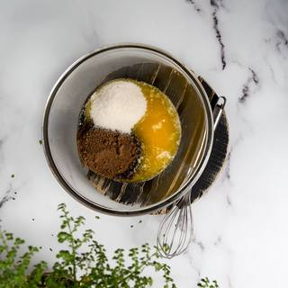 In another bowl, beat the melted butter with sugar and brown sugar and stir them well. You can whether use an electric mixer or using a spatula to blend it. Either of them works.
