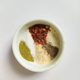 Measure the spices and put them all in a bowl and mix.