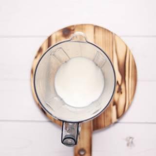 Pour milk into a blender.