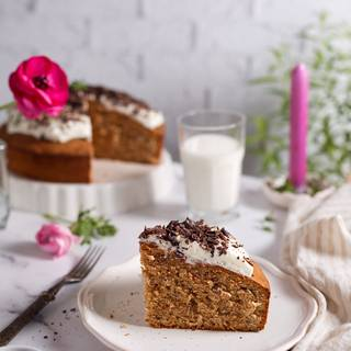 Let the cake cool down after cooking. You can use a spoon to cover your cake with cream cheese frosting and use some chocolate to decorate it. You can also cut your cake and put the cream cheese frostings in different layers. Enjoy your cake!