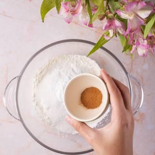 Mix flour, sugar, baking powder, salt, and cinnamon in a bowl.