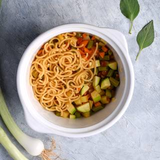 After frying and cooking the vegetables you need to add the pasta with a cup of water to the pot.