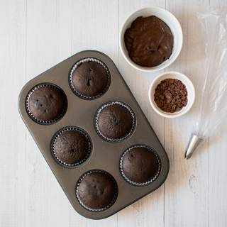 After 20 minutes take the cupcakes outside the oven. while they are cooling down we start making our chocolate frosting. Whisk the whipped cream with melted chocolates. Don't do it too much or your cream would lose its structure.