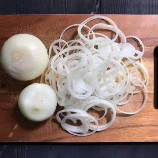 Cut the onions as thin as you can with a knife, separate the onion slices to have a crunchy french fried onions at the end.