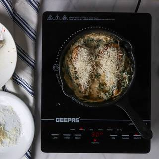Parmesan cheese on top in a cast-iron frying pan
