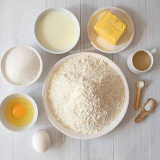 At first mix two tablespoons of instant yeast with half a cup of lukewarm water and one teaspoon of sugar. Put them in a warm place for about 10 to 15 minutes.
