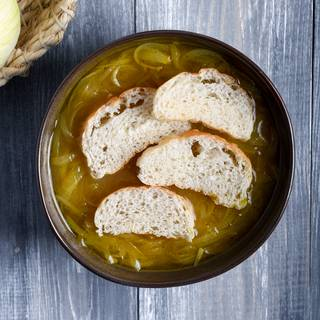 When your soup is cooked, turn on the oven to be heated. Pour the soup into a bowl and put some baguettes inside.