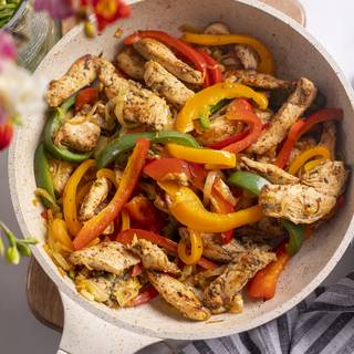 At this level, add the seared chicken to the bell pepper with salt, lemon-lime, and pepper. Sear for 5 minutes.