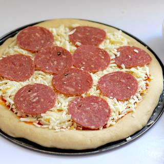 Pick the pepperonis on the cheese. The more pepperoni, the tastier your pizza is.