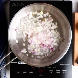 Sautéing onion in a steel pan