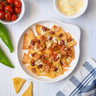Spread one layer of tortilla chips on the button of the skillet. Scatter some cheese, red beans, and shrimp on the top of the tortilla and combine it with salsa sauce.