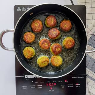 Turn the falafels so the other side is cooked as well.