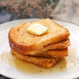 French toast with a slice of butter and honey