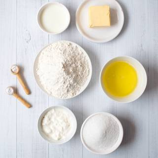 Prepare egg whites and yolks, then measure all the other ingredients.