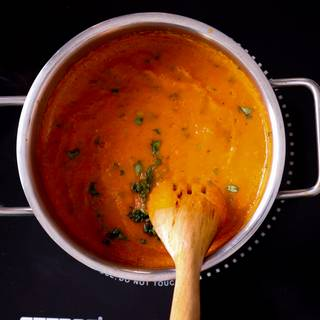Finally, add the chopped basil to your mixture and take the soup away from the heat immediately.