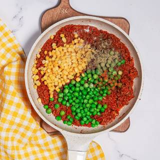 Add the green peas and thyme powder and mix them and let them cook on heat for 10 minutes.
