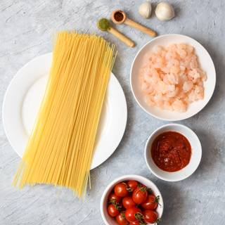 Fill 3/4 of a pot with water and add one tablespoon of salt to it. Put the pot on heat until the water starts to boil. Add the spaghetti to your water and let them cook for 10 minutes to become soft.