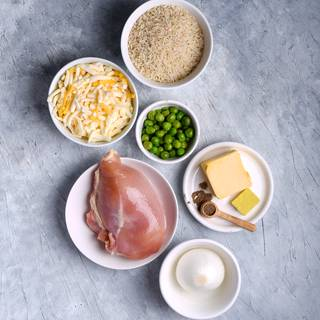 Prepare the ingredients for the chicken casserole and preheat the oven at 180C to warm up.