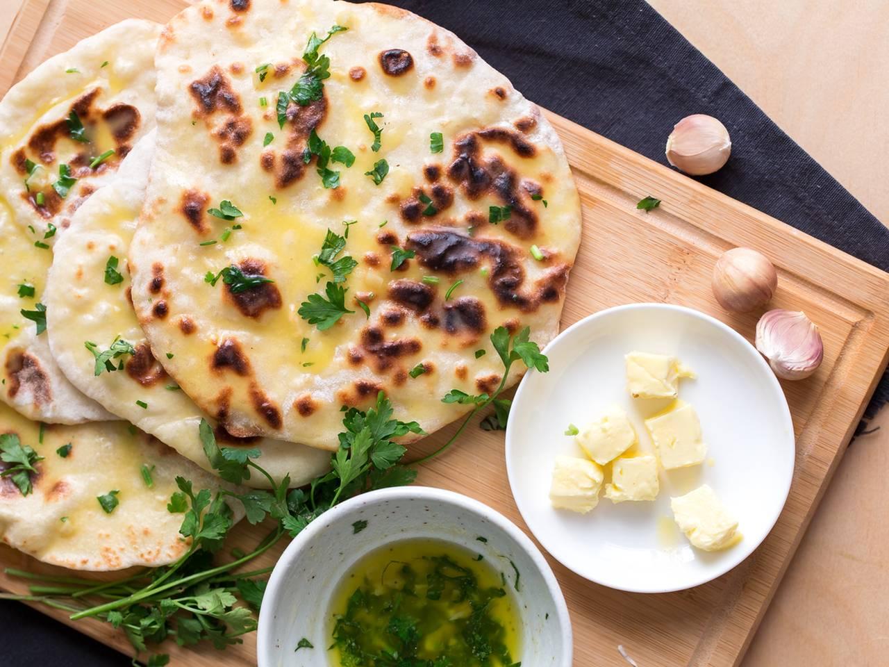 Warm Indian Garlic Naan With Pan