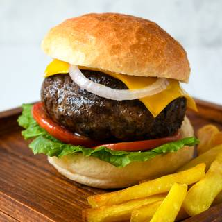 Spread your favorite sauce on the bun (ketchup, mustard, or mayonnaise) put the beef, lettuce, pickle, tomato, onion, and any other vegetables inside your bun. You can add some gouda cheese to your hot burger if you like. Your sandwich is ready.