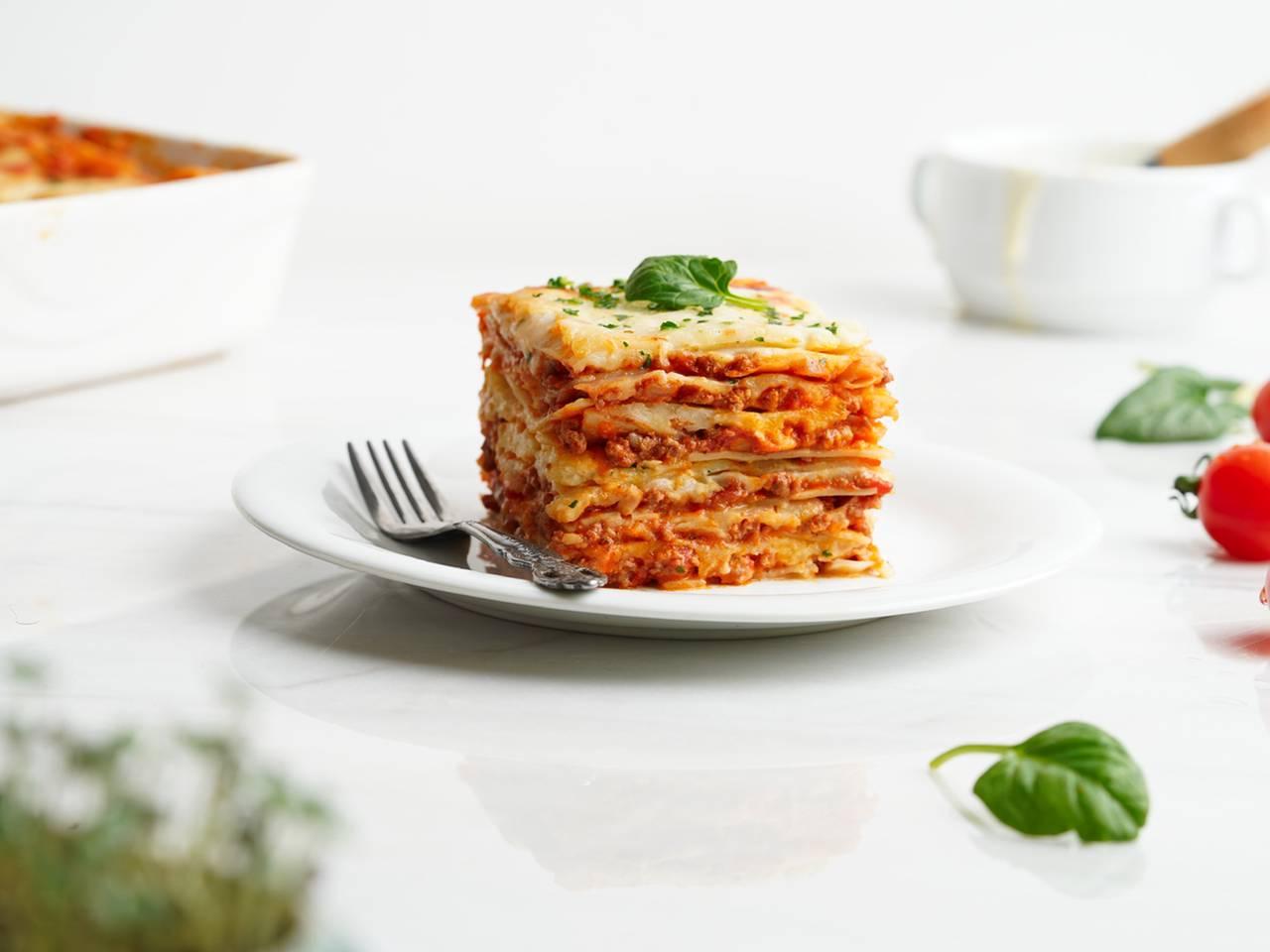 lasagna with spinach leaf garnish