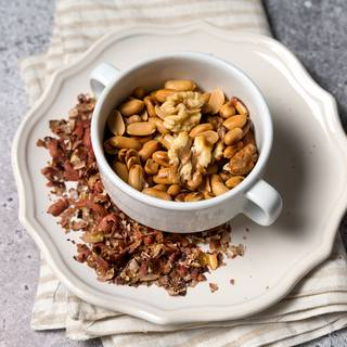 Fry the walnuts and peanuts and remove the skin as much as possible.