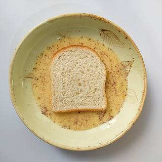 Roll a slice of toast in milk and egg liquid.