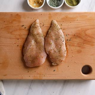 Season chicken thoroughly with spices.