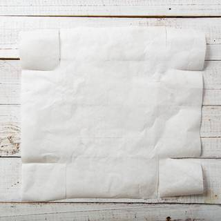 Cut the parchment paper to the size of your baking dish. cut four sides of it so you can cover all of your dishes.