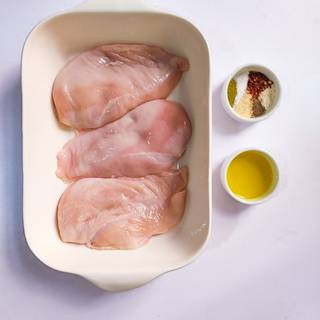 If the chicken breasts have bones, separate them from the bones. Place in a suitable oven.