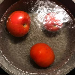 Bring a medium pot of water to a boil and then plunge the tomatoes into the boiling water.