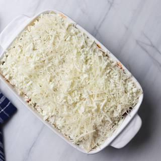 Mozzarella and Parmesan cheese on the last layer of lasagna