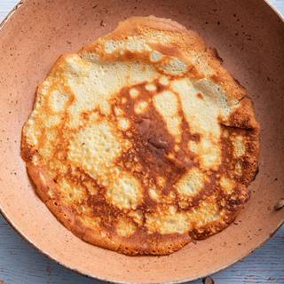 Before cooking each crepe, butter the pan well. Use the remaining butter to grease the pan and fry the crepes one by one.