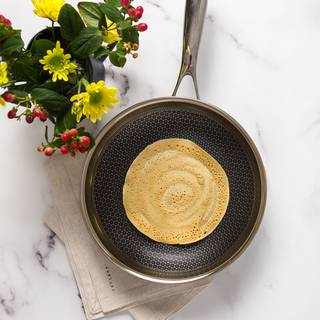 Pour one ladle of batter onto the pan. Tilt the pan with a circular motion so that the batter completely covers the bottom of the skillet or you can use your same ladle to help cover the pan.