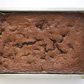 It's up to you how much you want to bake your brownie. If you enjoy its soft texture you can take your brownie out of the oven sooner but if you like it more crispy then you have to wait a little longer about 30 to 35 minutes.
