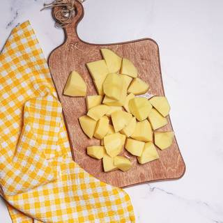 Peel and cut the potatoes into pieces and cook them.