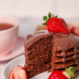 Now, you can serve it with chocolate sauce and fruits. Enjoy!