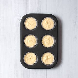 Put capsules in cupcakes' cases and fill 1\3 of the space with custard or patisserie and then put it in a pre-heated oven with 175 Fahrenheit degree.