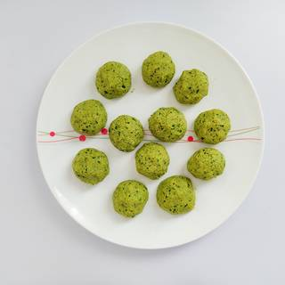 Make falafel balls with your hands or use a scoop to help you shape them better.