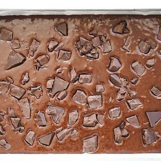 Put some parchment paper in your baking dish (30*20 cm). Pour the batter inside the dish and put the chocolate chips on top of the batter. Then put it in the oven (180°C or 350°F) bake it for about 20 to 25 minutes.