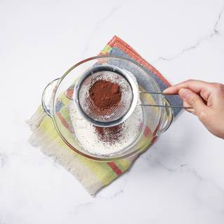 Sift cocoa powder.