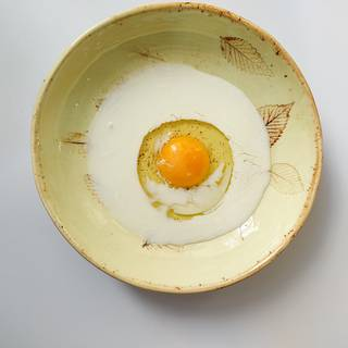 Egg and milk in a bowl