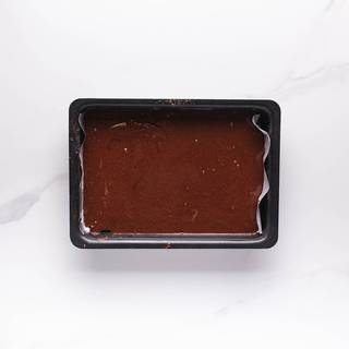 Grease your pan and pour the batter inside. Tap your pan a couple of times to release the air trapped in your batter. Preheat the oven at 180C and cook the brownies inside it for 30 minutes.